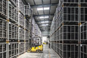 forklift moving stock in warehouse